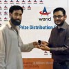 Manzar Khan (Left) won a diamond ring on valentine's day love meter contest of Warid.